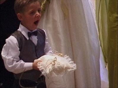 Small boy at wedding falls a sleep