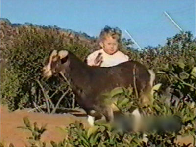 Kids play with goat – pushes them over