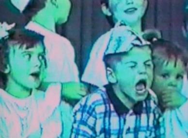 boy in choir shouting