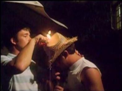 man's hat set on fire