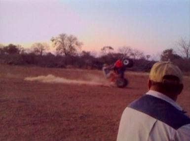 man falls off ATV