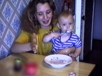 Mother feeding child spills food
