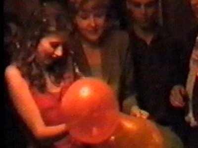 Burst balloon goes down woman's dress