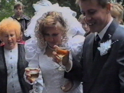 Bride tips champagne over herself