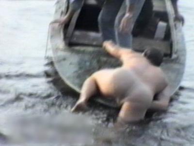 Men in boat capsize