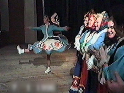 Woman Russian dancing falls over