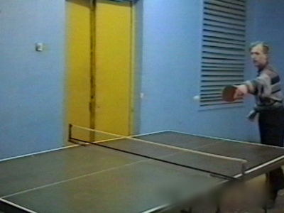 2 men playing table tennis, table breaks