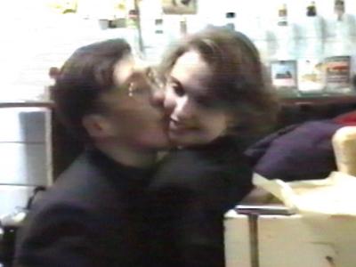 Man trying to kiss woman/woman bites man