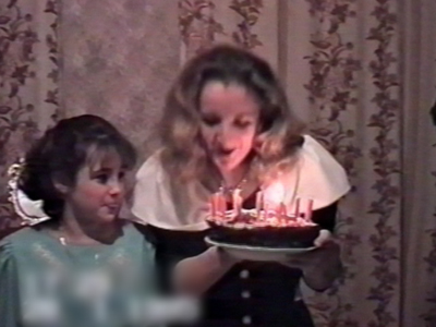 Woman blowing out candles catches hair on fire
