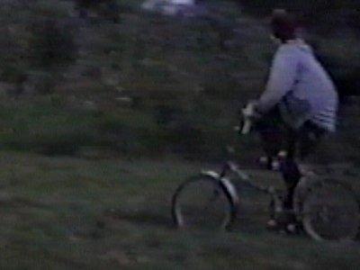 Boy on stilts knocked over by boy on bike