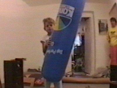 Boy kicks inflatable – hits camera