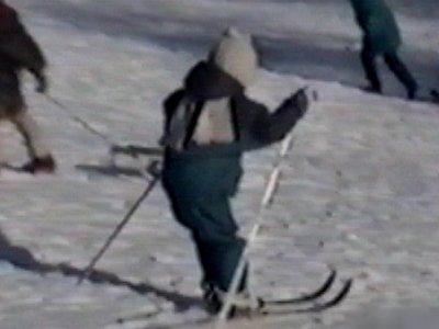 Child on skis crashes into tree