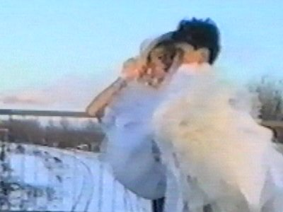 Groom carrying bride slips in snow