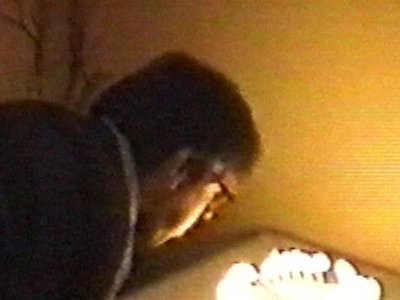 Man blows out candles – hand pops out of cake