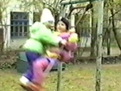 Two children on same swing – one falls off